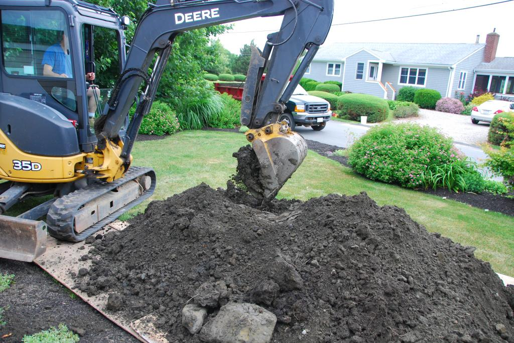 Excavating contractor drops removed dirt