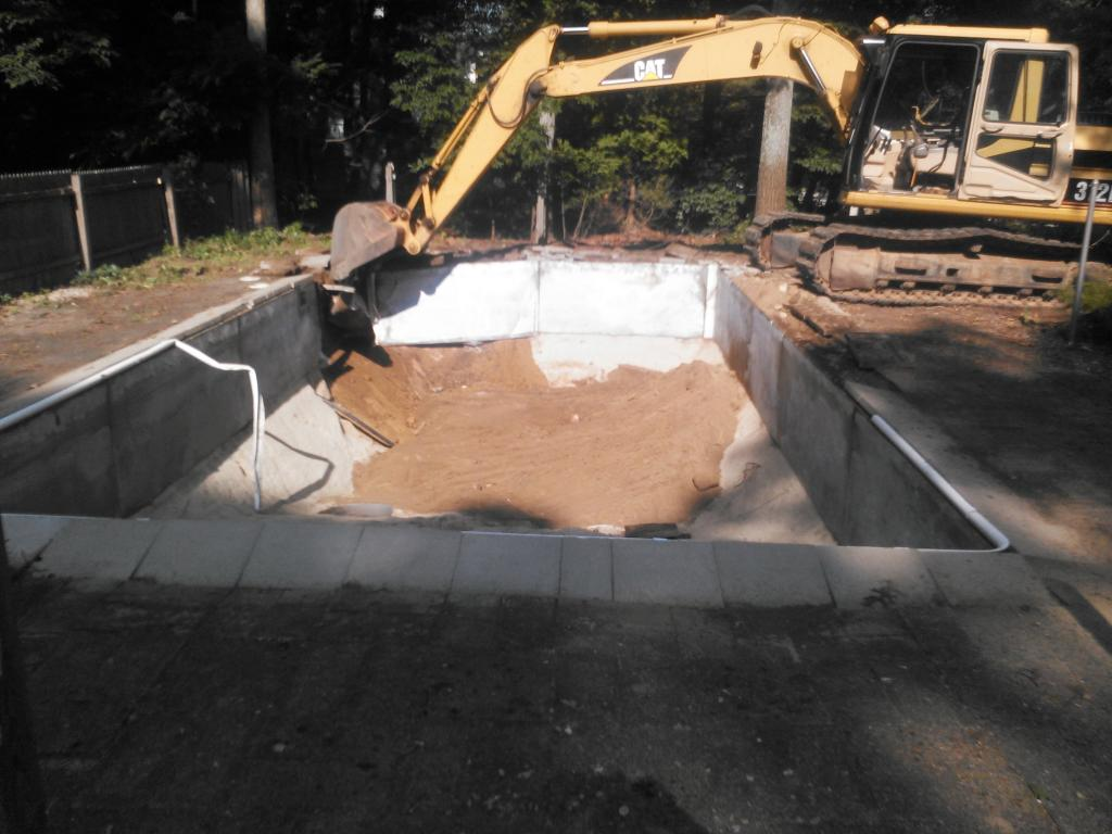 swimming pool being removed by Phil's Excavating
