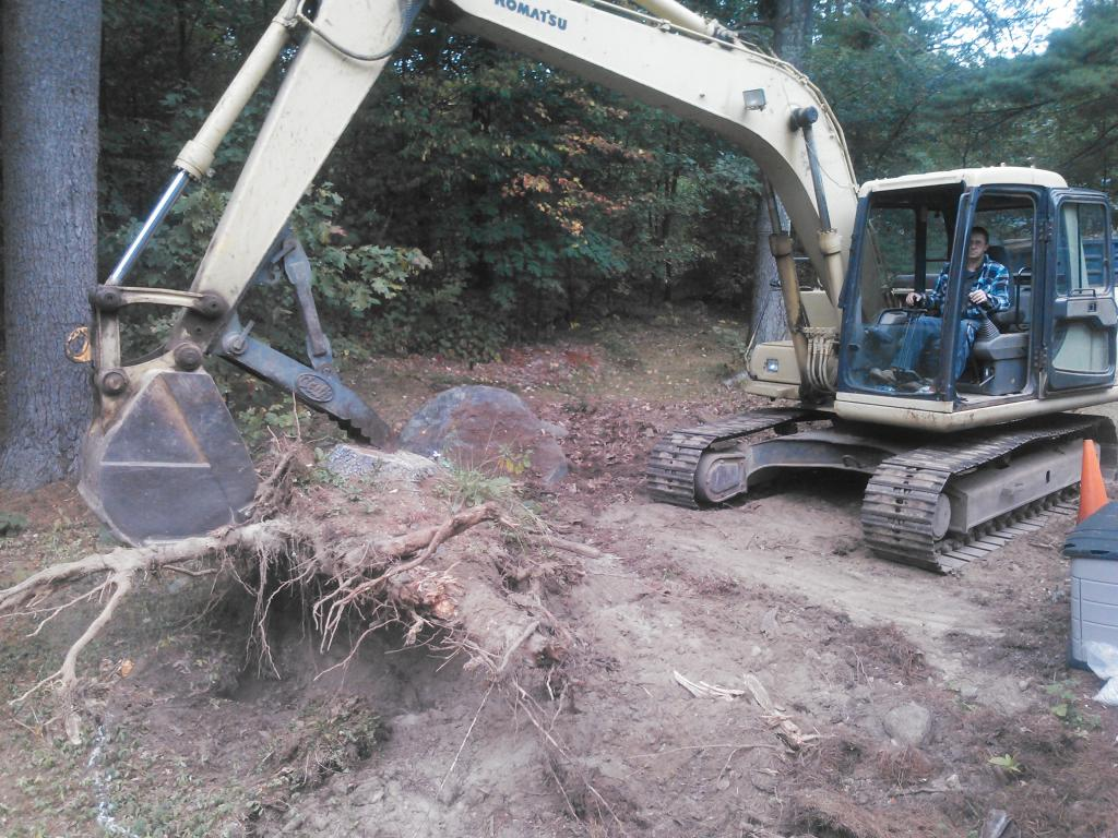 Phil's Excavating extracts large stump
