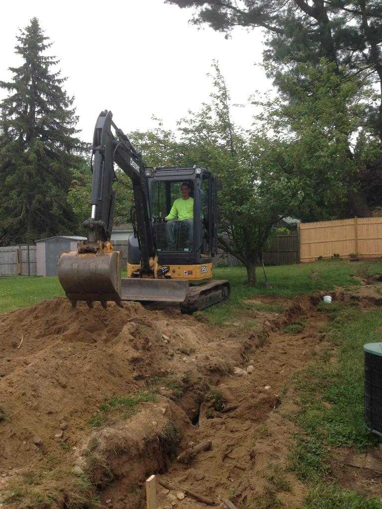 Phil's Excavating backfills trench